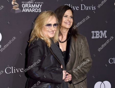 Melissa Etheridge, Linda Wallem. Melissa Etheridge, left, and Linda Wallem arrive at the Pre-Grammy Gala And Salute To Industry Icons at the Beverly Hilton Hotel, in Beverly Hills, Calif