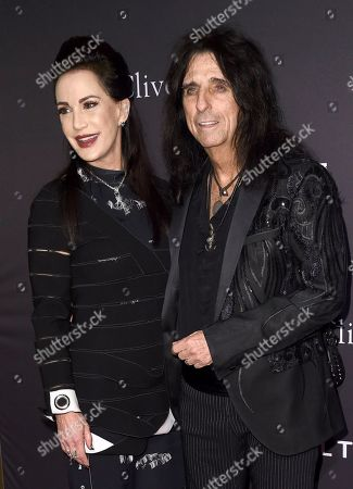 Alice Cooper, Sheryl Goddard. Alice Cooper, right, and Sheryl Goddard arrive at the Pre-Grammy Gala And Salute To Industry Icons at the Beverly Hilton Hotel, in Beverly Hills, Calif