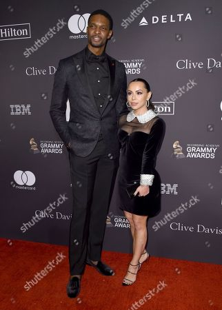 Chris Bosh, Adrienne Williams Bosh. Chris Bosh, left, and Adrienne Williams Bosh arrive at the Pre-Grammy Gala And Salute To Industry Icons at the Beverly Hilton Hotel, in Beverly Hills, Calif