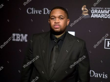 DJ Mustard arrives at the Pre-Grammy Gala And Salute To Industry Icons at the Beverly Hilton Hotel, in Beverly Hills, Calif