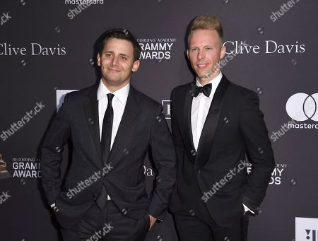 Benj Pasek, Justin Paul. Benj Pasek, left, and Justin Paul arrive at the Pre-Grammy Gala And Salute To Industry Icons at the Beverly Hilton Hotel, in Beverly Hills, Calif