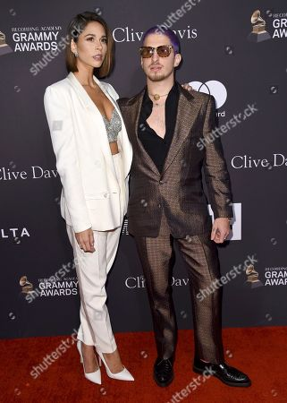 Ali Tamposi, Andrew Watt. Ali Tamposi, left, and Andrew Watt arrive at Pre-Grammy Gala And Salute To Industry Icons at the Beverly Hilton Hotel, in Beverly Hills, Calif