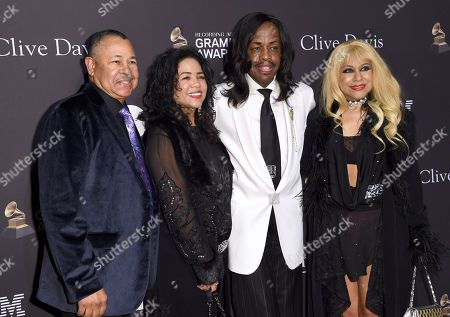 Ralph Johnson, Verdine White, Shelly Clark-White. Ralph Johnson, from left, Verdine White, Shelly Clark-White and guest arrive at Pre-Grammy Gala And Salute To Industry Icons at the Beverly Hilton Hotel, in Beverly Hills, Calif