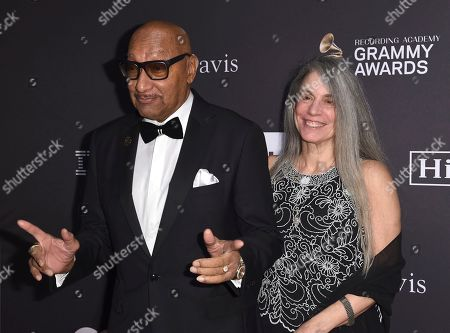 Abdul Fakir, left, and guest arrive at the Pre-Grammy Gala And Salute To Industry Icons at the Beverly Hilton Hotel, in Beverly Hills, Calif