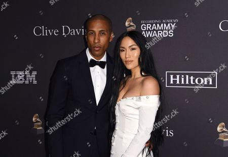 Larry Jackson, Stephanie Shepherd. Larry Jackson, left, and Stephanie Shepherd arrive at the Pre-Grammy Gala And Salute To Industry Icons at the Beverly Hilton Hotel, in Beverly Hills, Calif