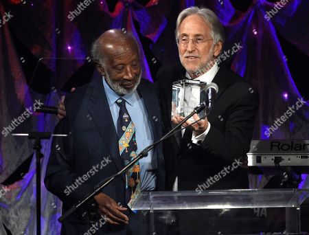 Clarence Avant, Neil Portnow. Neil Portnow, right, presents Clarence Avant with the 2019 Grammy Salute to Industry Icons Award at the Pre-Grammy Gala And Salute To Industry Icons at the Beverly Hilton Hotel, in Beverly Hills, Calif