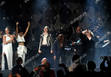 Chloe Bailey, Halle Bailey, Brandi Carlile, Ricky Minor, Keala Settle. Chloe Bailey, from left, Halle Bailey, Brandi Carlile, Ricky Minor, and Keala Settle perform at the Pre-Grammy Gala And Salute To Industry Icons at the Beverly Hilton Hotel, in Beverly Hills, Calif