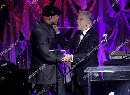 LL Cool J, Neil Portnow. LL Cool J, left, and Neil Portnow speak at the Pre-Grammy Gala And Salute To Industry Icons at the Beverly Hilton Hotel, in Beverly Hills, Calif