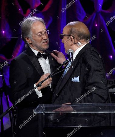 Neil Portnow, Clive Davis. Neil Portnow, left, and Clive Davis speak at the Pre-Grammy Gala And Salute To Industry Icons at the Beverly Hilton Hotel, in Beverly Hills, Calif