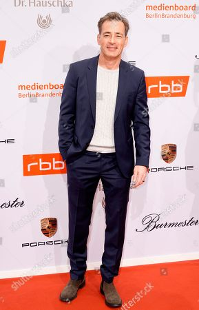 Stock Image of Gedeon Burkhard arrives on the red carpet of the reception of the Medienboard Berlin-Brandenburg (MBB) during the 69th annual Berlin Film Festival, in Berlin, Germany, 09 February 2019 (issued 10 February 2019). The Berlinale runs from 07 to 17 February 2019.