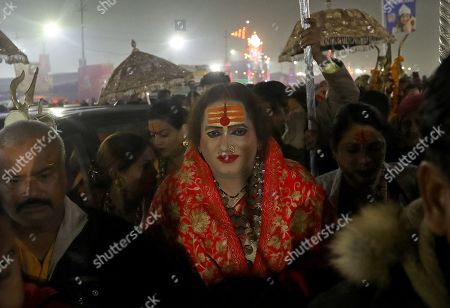 Stock Photo of Laxmi Narayan Tripathi (C), the head of the Kinnar Akhara along with members of her transgender congregation, is seen before taking a 'shahi snan' or holy bath at the Sangam, confluence of Ganga, Yamuna and the mythical Sarswati rivers, during the Kumbh Mela mass Hindu pilgrimage in Allahabad, Uttar Pradesh, India, 04 February 2019 (issued 10 February 2019). The Hindu festival is one of the biggest in India and the world with holy men called sadhu performing rituals.  The Kumbh Mela 2019 was held in Allahabad in Uttar Pradesh from 15 January 2019 to 04 March 2019.