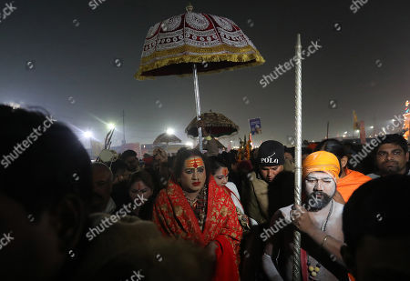 Laxmi Narayan Tripathi (C), the head of the Kinnar Akhara along with members of her transgender congregation, is seen before taking a 'shahi snan' or holy bath at the Sangam, confluence of Ganga, Yamuna and the mythical Sarswati rivers, during the Kumbh Mela mass Hindu pilgrimage in Allahabad, Uttar Pradesh, India, 04 February 2019 (issued 10 February 2019). The Hindu festival is one of the biggest in India and the world with holy men called sadhu performing rituals.  The Kumbh Mela 2019 was held in Allahabad in Uttar Pradesh from 15 January 2019 to 04 March 2019.