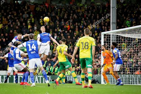 Ipswich Town defender Jonas Knudsen (3) wins this header during the EFL Sky Bet Championship match between Norwich City and Ipswich Town at Carrow Road, Norwich