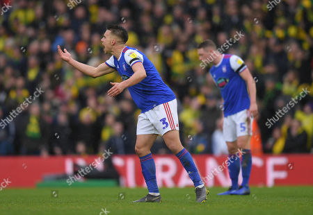 Jonas Knudsen of Ipswich Town shouts at team-mates