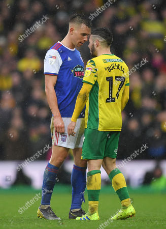 Jonas Knudsen of Ipswich Town and Emi Buendia of Norwich City square up to each other