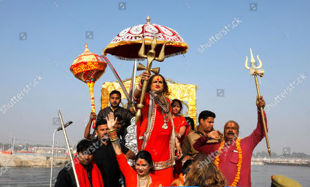"Stock Picture of Laxmi Narayan Tripathi, an Indian transgender activist and leader of the monastic order""Kinnar akhara"" returns in a procession after ritualistic dip on the auspicious day of Basant Panchami at Sangam, the confluence of sacred rivers the Yamuna, the Ganges and the mythical Saraswati, during the Kumbh Mela or the Pitcher Festival, in Prayagraj, Uttar Pradesh state, India, . The Kumbh Mela is a series of ritual baths by Hindu sadhus, or holy men, and other pilgrims at Sangam that dates back to at least medieval times. Pilgrims bathe in the river believing it cleanses them of their sins and ends their process of reincarnation"