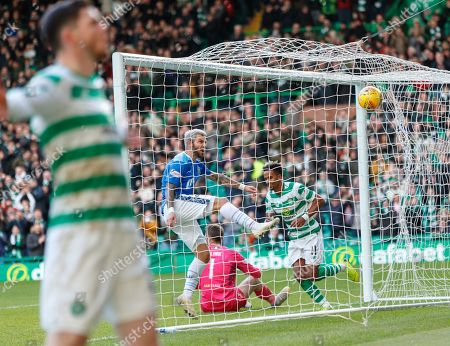 Richard Foster of St. Johnstone kicks the ball back into his own net in frustration after Scott Sinclair of Celtic (right) tapped the ball past St. Johnstone goalkeeper Zander Clark to give them a 4-0 lead. Oliver Burke of Celtic, who set up the goal celebrates in the foreground.