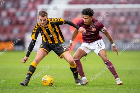 Steven Wilson (#11) of Auchinleck Talbot FC shields the ball from Demetri Mitchell (#11)  of Heart of Midlothian during the William Hill Scottish Cup match between Heart of Midlothian FC and Auchinleck Talbot FC at Tynecastle Stadium, Edinburgh