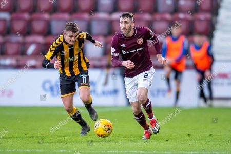 Michael Smith (#2) of Heart of Midlothian sprints clear of Steven Wilson (#11) of Auchinleck Talbot FC during the William Hill Scottish Cup match between Heart of Midlothian FC and Auchinleck Talbot FC at Tynecastle Stadium, Edinburgh