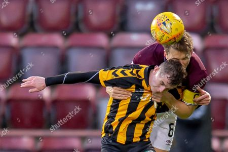 Christophe Berra (#6) of Heart of Midlothian wins a header against Steven Wilson (#11) of Auchinleck Talbot FC during the William Hill Scottish Cup match between Heart of Midlothian FC and Auchinleck Talbot FC at Tynecastle Stadium, Edinburgh
