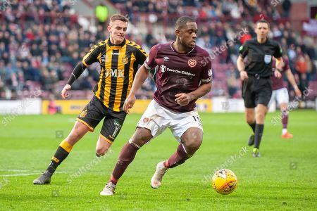 Uche Ikpeazu (#19) of Heart of Midlothian holds the ball up ahead of Steven Wilson (#11) of Auchinleck Talbot FC during the William Hill Scottish Cup match between Heart of Midlothian FC and Auchinleck Talbot FC at Tynecastle Stadium, Edinburgh