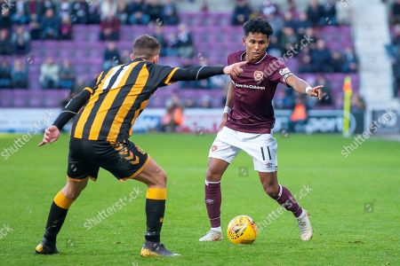 Demetri Mitchell (#11)  of Heart of Midlothian looks to beat Steven Wilson (#11) of Auchinleck Talbot FC during the William Hill Scottish Cup match between Heart of Midlothian FC and Auchinleck Talbot FC at Tynecastle Stadium, Edinburgh