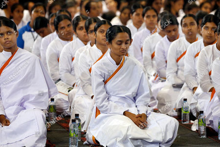 White-clad Sri Lankan females attend an awareness raising event on the futility of blindly following Valentine's day organized by the Mahamevna Bawana Asapuwa, a Buddhist organization at the Sugathadasa Indoor Stadium in Colombo, Sri Lanka, 10 February 2019. An awareness raising meeting with the theme 'Yovun Daham Sakmana' (Religious Journey for the Youth), on blindly following the highly commercialized Valentine?s Day celebrations in the island nation and instead to utilize the day to spread the Buddhist principles of love, affection, blessings on all living things was held prior to the lovers' day which falls on 14 February. Thousands, especially the youth, clergy and laymen from all religions and races island-wide participated at this unique event.