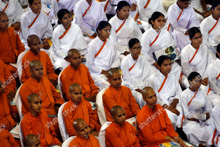 Sri Lankan Buddhist clergy and laymen attend an awareness raising event on the futility of blindly following Valentine's day organized by the Mahamevna Bawana Asapuwa, a Buddhist organization at the Sugathadasa Indoor Stadium in Colombo, Sri Lanka, 10 February 2019. An awareness raising meeting with the theme 'Yovun Daham Sakmana' (Religious Journey for the Youth), on blindly following the highly commercialized Valentine?s Day celebrations in the island nation and instead to utilize the day to spread the Buddhist principles of love, affection, blessings on all living things was held prior to the lovers' day which falls on 14 February. Thousands, especially the youth, clergy and laymen from all religions and races island-wide participated at this unique event.