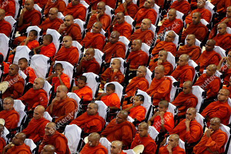 Stock Image of Sri Lankan Buddhist monks attend an awareness raising event on the futility of blindly following Valentine's day organized by the Mahamevna Bawana Asapuwa, a Buddhist organization at the Sugathadasa Indoor Stadium in Colombo, Sri Lanka, 10 February 2019. An awareness raising meeting with the theme 'Yovun Daham Sakmana' (Religious Journey for the Youth), on blindly following the highly commercialized Valentine?s Day celebrations in the island nation and instead to utilize the day to spread the Buddhist principles of love, affection, blessings on all living things was held prior to the lovers' day which falls on 14 February. Thousands, especially the youth, clergy and laymen from all religions and races island-wide participated at this unique event.