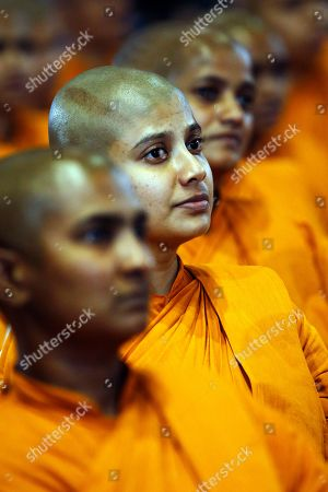 Sri Lankan 'dasa sil mathas' or Buddhist nuns attend an awareness raising event on the futility of blindly following Valentine's day organized by the Mahamevna Bawana Asapuwa, a Buddhist organization at the Sugathadasa Indoor Stadium in Colombo, Sri Lanka, 10 February 2019. An awareness raising meeting with the theme 'Yovun Daham Sakmana' (Religious Journey for the Youth), on blindly following the highly commercialized Valentine?s Day celebrations in the island nation and instead to utilize the day to spread the Buddhist principles of love, affection, blessings on all living things was held prior to the lovers' day which falls on 14 February. Thousands, especially the youth, clergy and laymen from all religions and races island-wide participated at this unique event.