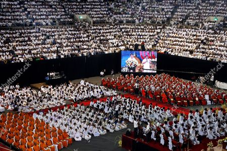 Stock Picture of Sri Lankan youth attend an awareness raising event on the futility of blindly following Valentine's day organized by the Mahamevna Bawana Asapuwa, a Buddhist organization at the Sugathadasa Indoor Stadium in Colombo, Sri Lanka, 10 February 2019. An awareness raising meeting with the theme 'Yovun Daham Sakmana' (Religious Journey for the Youth), on blindly following the highly commercialized Valentine?s Day celebrations in the island nation and instead to utilize the day to spread the Buddhist principles of love, affection, blessings on all living things was held prior to the lovers' day which falls on 14 February. Thousands, especially the youth, clergy and laymen from all religions and races island-wide participated at this unique event.