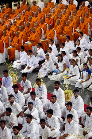 Sri Lankan Buddhist clergy and laymen during an awareness raising event on the futility of blindly following Valentine's day organized by the Mahamevna Bawana Asapuwa, a Buddhist organization at the Sugathadasa Indoor Stadium in Colombo, Sri Lanka, 10 February 2019. An awareness raising meeting with the theme 'Yovun Daham Sakmana' (Religious Journey for the Youth), on blindly following the highly commercialized Valentine?s Day celebrations in the island nation and instead to utilize the day to spread the Buddhist principles of love, affection, blessings on all living things was held prior to the lovers' day which falls on 14 February. Thousands, especially the youth, clergy and laymen from all religions and races island-wide participated at this unique event.