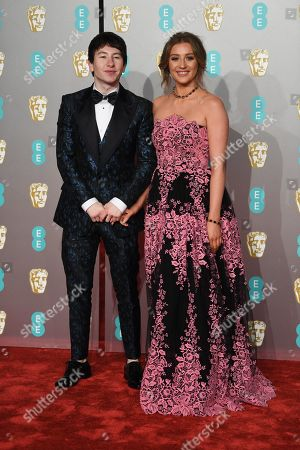 Barry Keoghan (L) with a guest attends the 72nd annual British Academy Film Awards at the Royal Albert Hall in London, Britain, 10 February 2019. The ceremony is hosted by the British Academy of Film and Television Arts (BAFTA).