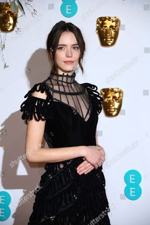Stacey Martin poses for photographers upon arrival at the BAFTA awards in London
