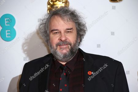 Peter Jackson poses for photographers upon arrival at the BAFTA awards in London