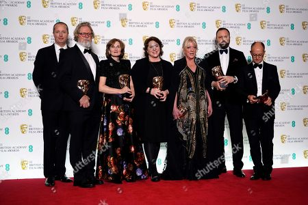 Producer Andrew Lowe, Tony McNamara, Deborah Davis, Lee Magiday, Ceci Dempsey, director Yorgos Lanthimos and Ed Guiney pose in the press room during the 72nd annual British Academy Film Awards at the Royal Albert Hall in London, Britain, 10 February 2019. The ceremony is hosted by the British Academy of Film and Television Arts (BAFTA).