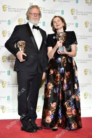Tony Mcnamara and Deborah Davis with their awards for Original Screenplay for 'The Favourite' in the press room during the 72nd annual British Academy Film Awards at the Royal Albert Hall in London, Britain, 10 February 2019. The ceremony is hosted by the British Academy of Film and Television Arts (BAFTA).