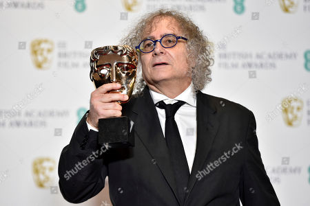 Hank Corwin poses with his award for 'Best Editing' for the movie 'Vice' in the press room during the 72nd annual British Academy Film Awards at the Royal Albert Hall in London, Britain, 10 February 2019. The ceremony is hosted by the British Academy of Film and Television Arts (BAFTA).