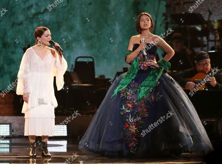 """Natalia Lafourcade, Angela Aguilar. Natalia Lafourcade, left, and Angela Aguilar perform """"La Llorona"""" at the 61st annual Grammy Awards, in Los Angeles"""