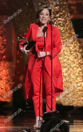 "Claudia Brant accepts the award for best Latin pop album for ""Sincera"" at the 61st annual Grammy Awards, in Los Angeles"