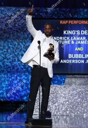 """Jay Rock accepts the award for best rap performance for """"King's Dead"""" at the 61st annual Grammy Awards, in Los Angeles"""