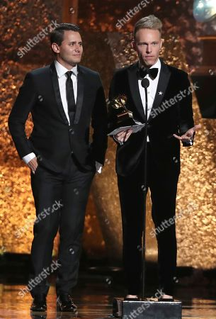 """Benj Pasek, Justin Paul. Benj Pasek, left, and Justin Paul accept the award for compilation soundtrack for visual media for """"The Greatest Showman"""" at the 61st annual Grammy Awards, in Los Angeles"""