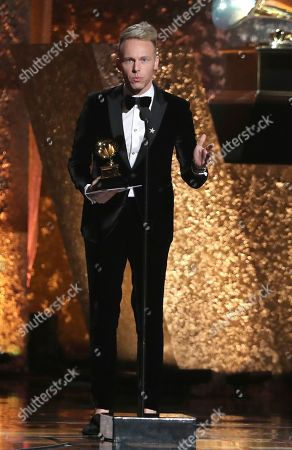 """Justin Paul accepts the award for compilation soundtrack for visual media for """"The Greatest Showman"""" at the 61st annual Grammy Awards, in Los Angeles"""