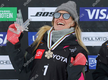 Third-place finisher Jamie Anderson, of the United States, celebrates on the podium following the women's slopestyle snowboard world championship, in Park City, Utah
