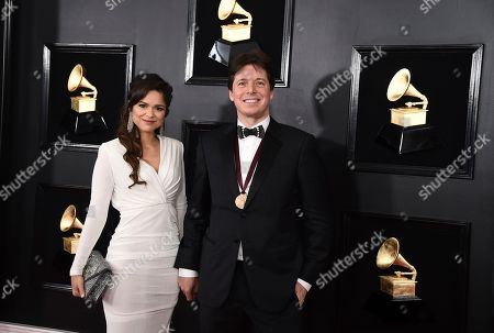 Larisa Martinez, Joshua Bell. Larisa Martinez, left, and Joshua Bell arrive at the 61st annual Grammy Awards at the Staples Center, in Los Angeles