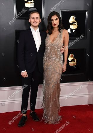 Guy Lawrence, left, arrives at the 61st annual Grammy Awards at the Staples Center, in Los Angeles