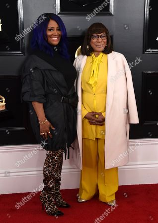 Lalah Hathaway, left, arrives at the 61st annual Grammy Awards at the Staples Center, in Los Angeles