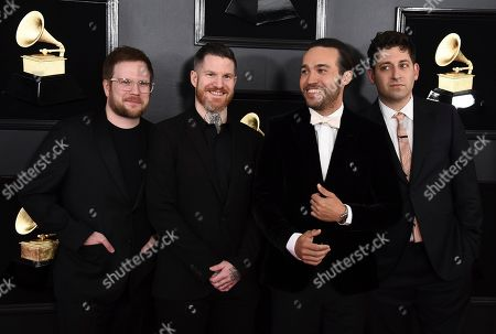 Patrick Stump, Andy Hurley, Pete Wentz, Joe Trohman. Patrick Stump, from left, Andy Hurley, Pete Wentz, and Joe Trohman arrive at the 61st annual Grammy Awards at the Staples Center, in Los Angeles
