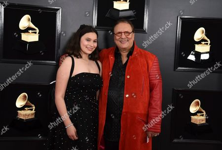Arturo Sandoval, right arrives at the 61st annual Grammy Awards at the Staples Center, in Los Angeles