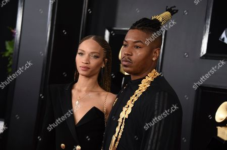 Devan Mayfield, Christian Scott aTunde Adjuah. Devan Mayfield, left, and Christian Scott aTunde Adjuah arrive at the 61st annual Grammy Awards at the Staples Center, in Los Angeles